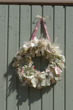 A green, pink and cream material wreath I made using ideas from Pinterest :)