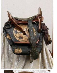 Although images of the saddle tree (kurabane) of the samurai saddle are available images of many the other items that went into making up the full ensemble are not as easy to find. I have collected