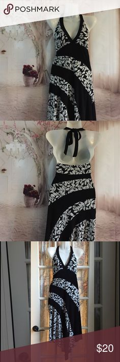 👗Fab date night dress 👗 Black with white roses, this asymmetrical halter is as comfortable as impressive! Candie's Dresses Asymmetrical
