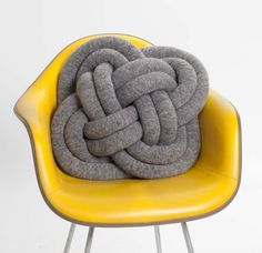 This is one cool pilow! I like the chair too!