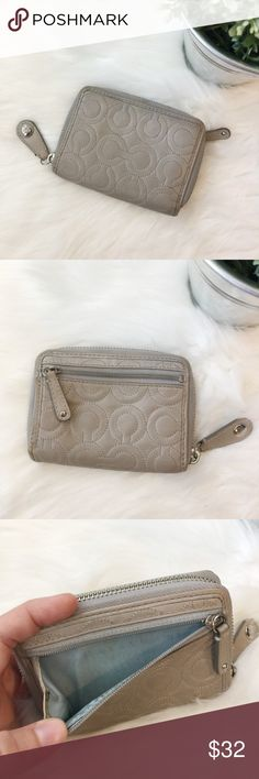 Coach Gramercy Gray Zip Around wallet Coach Gramercy zipper wallet. Gray leather with silver hardware. Zipper pocket on back for coins. Many different compartments in interior. Pre-loved and slight discoloration on edges and inside coin Pouch. Zippers work great! 5 inches long, 3.5 inches tall. Coach Bags Wallets