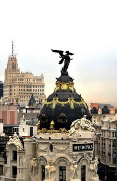 Angel on top of Metropolis Building, Madrid, Spain. Places Around The World, Oh The Places You'll Go, Travel Around The World, Places To Travel, Places To Visit, Around The Worlds, Foto Madrid, Famous Castles, Spain And Portugal