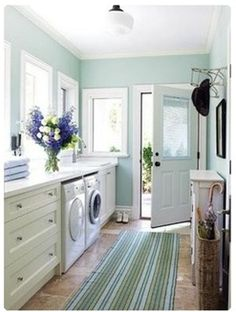 laundry room - a most fabulous one!  Love the long counter and all the windows.
