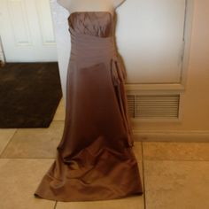 Strapless Gown Worn once. Used as a bridesmaid gown. Beautiful champagne colored strapless gown. Very elegant and in excellent condition. David's Bridal Dresses