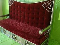 High backed spider web and casket based couch. Nice!