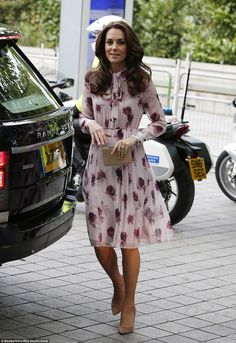 Kate looks impeccably polished in a Kate Spade New York silk dress with neutral accessories