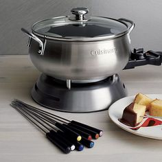 Plug into flame-less fondue with this handy new version from Cuisinart. They've thought of everything, from the built-in heating element, to the adjustable thermostat, to the easy-clean nonstick finish. You can prepare chocolate, cheese, broth or oil fondues in the sleek brushed stainless pot.