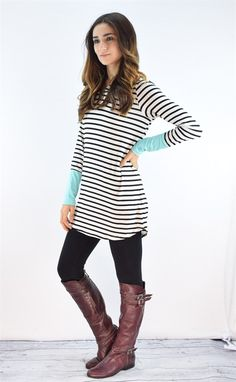"""This luxurious tunic is a comfortable classic. Pair this with tall boots and your favorite jeans!  Fits true to size model is size 4, 5'6"""" tall and she wears size small.Sizes (Fits true to size in relaxed) Small (0-4)Medium (6-8)Large (10-12)95% rayon 5% spandexMade in USA"""