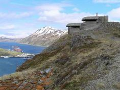 Perched on jagged peaks in one of the most remote regions of the United States, the decaying Dutch Harbor Bunkers have sat silent and empty for over six decades. Their solid concrete forms blend into the crumbling rock around them, a reminder of the history of the Aleutian Islands Campaign in which the U.S. military struggled to regain control of these Alaskan outposts.