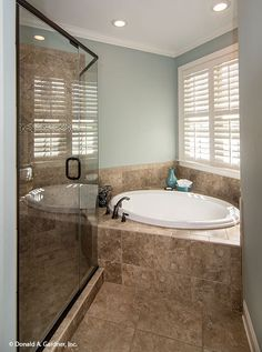 This #master #bathroom features a corner garden bathtub. The Weatherford #1053. http://www.dongardner.com/house-plan/1053/the-weatherford. #DreamHome