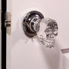 Love this skull doorknob -- aside from the design, glass knobs remind me of my childhood home.