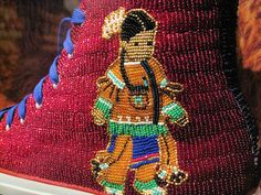 Beaded converse. Unfortunately site is not available to see who beaded this and original pinner didn't note who the beader is :-( Could be Teri Greeves??