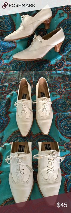 Vintage Stuart Weitzman kitten heel oxfords Just gorgeous leather and fabric combo wing-tip, pointy toe kitten heel lace-up oxfords from Stuart Weitzman.  These are in good shape but show a few signs of love.  There are a few but hardly noticeable little dirt marks (white shoes, amirite?) in the fabric part and what appears to be some glue that escaped in the manufacturing process on the back right heel seam. Also appears to be spot that may have been a drop of red wine (?) on the left tip…