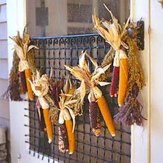Cornhusk Garland --- Now this is cool looking... Make certain you have a FULLY-COVERED area if you're thinking of placing this outside. Your front porch corn husks will mildew and attract varmints if installed on an un-protected porch in Atlanta, I can promise you... Beware of squirrels; rats with tails!!!