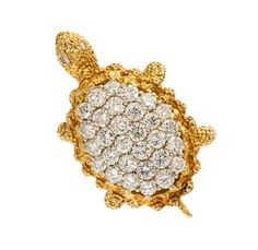 An 18 Karat Yellow Gold and Diamond Turtle Brooch,  in a stippled texture design, the shell and eyes containing 32 round brilliant cut diamonds weighing approximately 4.65 carats total.  Stamp: 18K (obscured maker's mark).