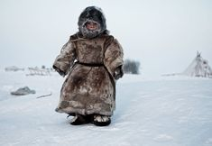 Living on the Tundra. A young Nenet boy in Siberia plays in -30 degrees. (© Simon Morris/National Geographic Traveler Photo Contest)