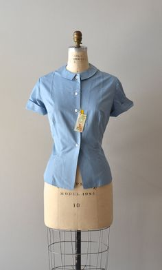 A lovely, classic 1950s blue silk short sleeved blouse. #vintage #1950s #fashion #spring #summer