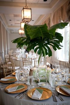 pinterest tropical centerpiece | tropical leaves centerpiece | Tablescapes; this would work well for tables 2, 3 and 14 at the Jepson, with just the leaves and no flowers