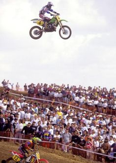 """Jeff Emig taking on the massive downhill quad in his first ever race aboard a 500 (Kawasaki) at the '96 MXdN held in Jerez, Spain.    The bike was infact a '93 model instead of an """"up to date"""" '96 model, the technicians switched out the forks/shock and BNG (bold new graphics) units, this bike was used every year up until this point by a Kawi rider for sole use at the MXDN, 2 bikes were in use, 1 a practice bike and the other a race bike (pictured)."""