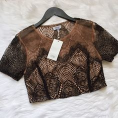 TOBI Lace Crop Top Beautiful lace crop top from TOBI. NWT. Never had a chance to wear. This has no flaws. Perfect for a night out! Tobi Tops