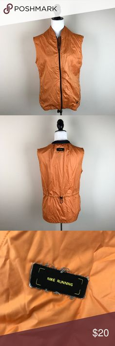 """Nike Running Orange Windbreaker Vest Orange running vest. Adjustable waist in the back. Gently worn and in good condition except for around the labels - there are loose/worn looking threads coming out around all of the logos on the vest. Please see photos. 100% polyester.  Measurements laying flat (without stretching)— Armpit to armpit: 20"""" Length (shoulder to hem):  —Front: 24"""" —Back: 26"""" Nike Jackets & Coats Vests"""