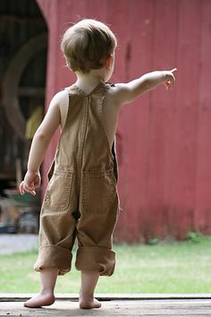 Little boy in overalls....
