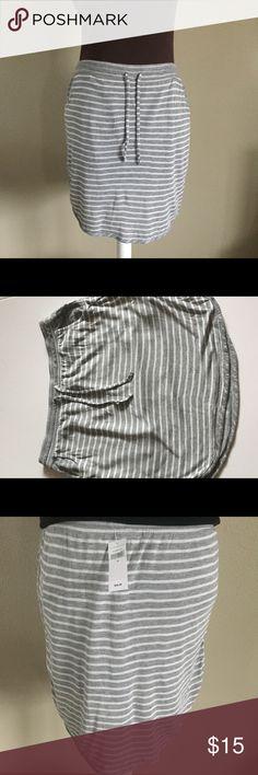 GAP gray & white striped skirt Cute casual GAP gray and white striped skirt. Cute for a casual day or a swimsuit. Size medium. No trades. GAP Skirts Midi
