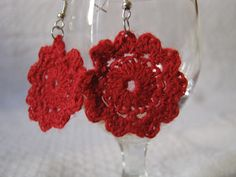 A pair of red crocheted earrings. $9.00