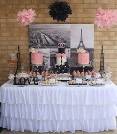love this for a bridal shower photos in the back and the table decor