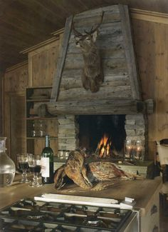 i love the warm wood fireplace mantle - i would definitely be replacing the mounted deer head with something else - maybe snow shoes or old skis? Wood Fireplace Mantel, Rustic Fireplaces, Fireplace Mantle, Fireplace Design, Kitchen Fireplaces, Rock Fireplaces, Fireplace Ideas, Log Cabin Living, Little Cabin