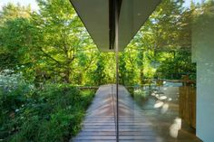 Falkenberg Innenarchitektur transformed a compact 1950s home into a stunning minimalist retreat tucked into an idyllic forest in Germany.