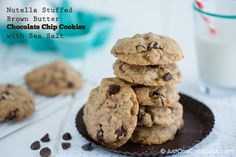 Best chocolate chip cookie recipe made with brown butter, stuffed with Nutella, and sprinkled with sea salt.
