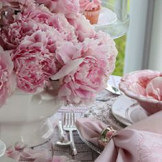 What about white linens, silver/pewter chargers, white dishes and pink napkins & sashes?