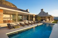 The outdoor oasis boasts a swimming pool bordered by covered terraces with alfresco living and dining spaces.