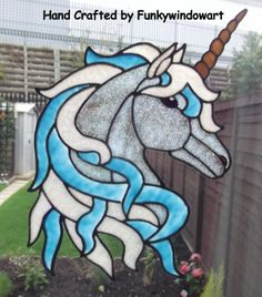 Unicorn Window Cling, this would work in stained glass with a couple of modifications. .. :)