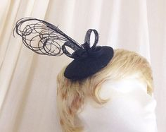 Black curled feather and sinamay cocktail derby hat