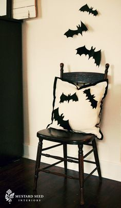 Not a huge fan of Halloween, but I kind of like this. From Miss Mustard Seed. I am imagining black felt bats, that could be pinned to the pillow and then adhered to the wall.