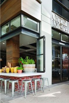 TrendThing: cafe design /// Capital Kitchen // (RZK likes the idea of setting back the outside wall so you could seat out on the street side. A walk up would work well in CB)
