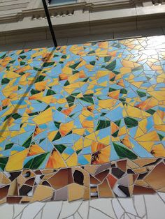 Detail view of Apple Store tile mosaic in Barcelona using colors from the Photos iOS app icon