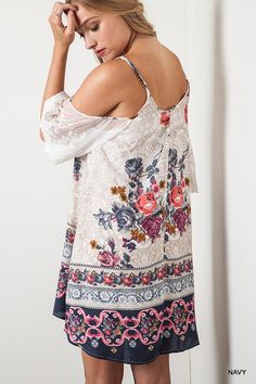 f6f7a5e281a We just adore this floral print dress! The cut out shoulder is perfect for  the