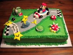 Mario Kart Birthday Cake I made this cake for a 7 yr olds birthday. One of my first cakes. It's covered in buttercream and the road...