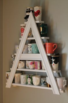 I collect different mugs and my name starts with an A.TROPHY WIFE Must Have! Custom White Wood Painted Tea or Coffee Mug Rack Letter A or Triangle or Other Letter Coffee Mug Storage, Coffee Mugs, Coffee Mug Display, Coffee Lovers, Coffee Maker, Diy Deco Rangement, Diy Casa, Mug Rack, Ideas Para Organizar