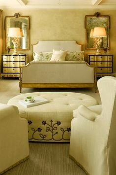 Things That Inspire.  Here is a bedroom designed by JFS Design Studio, with symmetrical mirrors on either side of the bed, but nothing above the headboard.
