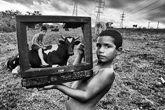 This project is called B & W TV (Black and White TV), is referring to people living in the suburbs of the metropolitan area of Porto Alegre, capital of Rio Grande do Sul, Brazil. The project consists of scrap through television to give an identity to these people in need of attention in the social environment.    My name is Tadeu Vilani, I have 47 years working in the newspaper Zero Hora in Porto Alegre, I'm 16 years working with photojournalist.