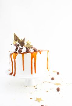 This decadent sweet potato cake with marshmallow frosting and a caramel glaze is the perfect fall treat.