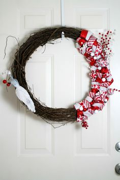 This Red and White Ribbon and Ornament Christmas Wreath is a great diy wreath project anyone can tackle!