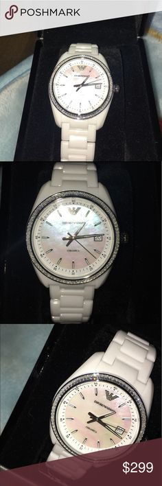 EMPORIO ARMANI Ceramica Mother of Peal Dial New with tags never been used in great condition no scratches no dAmage no flaws.  CASE SIZE: 39 MM CASE THICKNESS: 10 MM LUG WIDTH: 20 MM WATER RESISTANT: 5 ATM PACKAGING: EMPORIO ARMANI WATCH BOXBRAND:Emporio Armani MODEL:AR1497 GENDER:Ladies MOVEMENT:Quartz CASE SIZE:39 mm CASE THICKNESS:10 mm CASE MATERIAL:Ceramic CASE SHAPE:Round CASE BACK:Solid DIAL TYPE:Analog DIAL COLOR:Mother of Pearl CRYSTAL:Scratch Resistant Mineral HANDS:Luminous…
