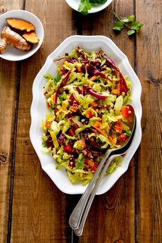 Indian spiced coleslaw with fresh turmeric, coconut, lime, chilis and cilantro | A Communal Table