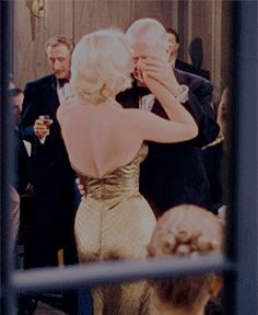 """Marilyn Monroe wearing the iconic gold dress in Gentlemen Prefer Blondes (1953)."""