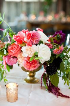 bright pink #centerpiece Photography: Laurel McConnell Photography - mcconnellphoto.com  Read More: http://www.stylemepretty.com/northwest-weddings/2014/04/10/travel-themed-diy-wedding-in-seattle/